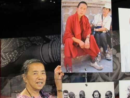 Ruth and picture of herself with monk whose boots she brought in Gansu, China.