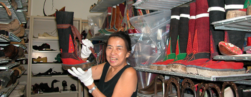 "Ruth in the Museum's vault with some of ""her"" Tibetan  boots in 2005. Copyright ©2013 Ruth Lor Malloy"