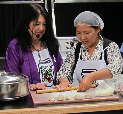 Sonam Yangzom (right) uses a rolling pin.  Copyright ©2013 Ruth Lor Malloy