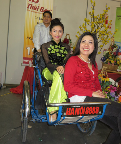 Tina (left) and April  in a Hanoi Trishaw. Copyright ©2014 Ruth Lor Malloy.