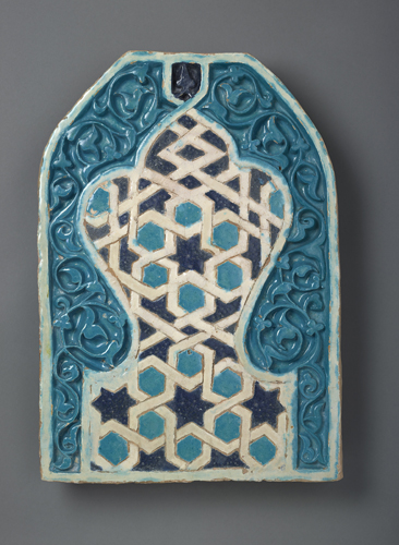 Tile Panel. Central Asia. 14th Century. Earthenware, carved & glazed. 56 X 39 cm. AKM572. Image courtesy Aga Khan Museum.