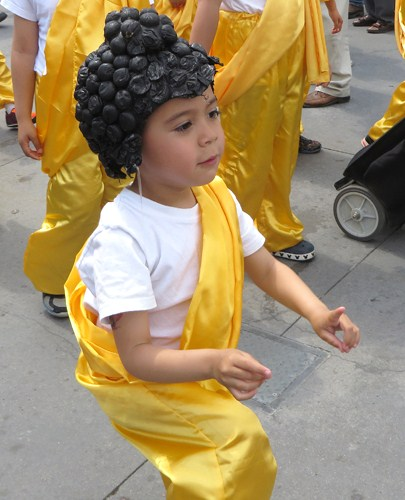Little Buddhas at end of parade, still with proper hand positions.  Copyright ©2015 Ruth Lor Malloy