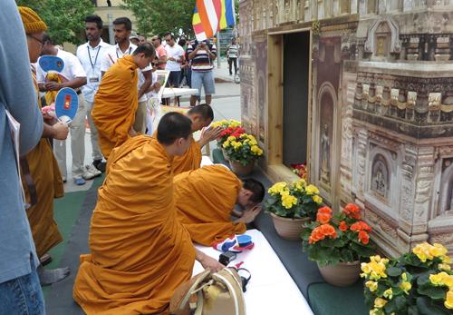Paying homage at replica of Bodhgaya temple.  Copyright ©2015 Ruth Lor Malloy