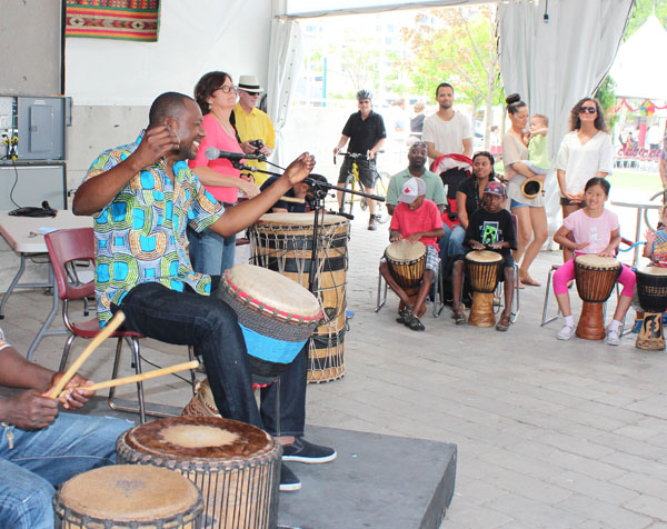 Amadou Kienou teaching West African drumming at Harbourfront Centre. Image Copyright ©2016 Ruth Lor Malloy