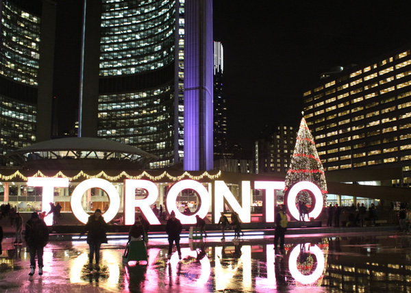 Toronto City Hall ice rink with layer of water and determined skaters on top, a result of climate change. November, 2016.  Image Copyright ©2016 Ruth Lor Malloy